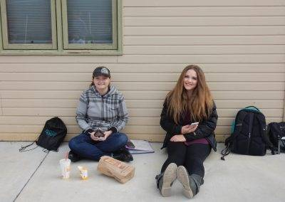 students eating lunch against wall